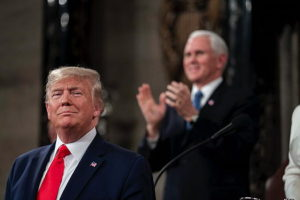 Donald Trump with Pence in the background