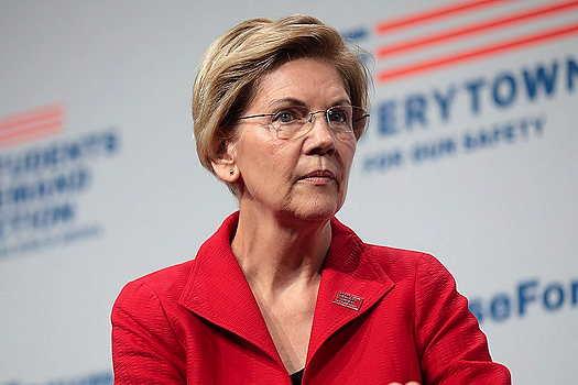 Elizabeth Warren wearing a red jacket