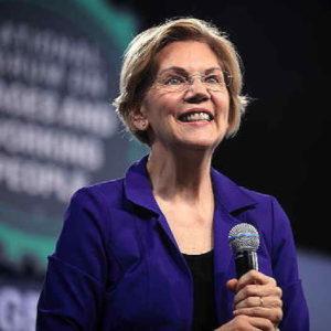 Elizabeth Warren wearing a purple jacket