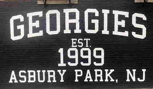 Georgies Bar sign on brick wall