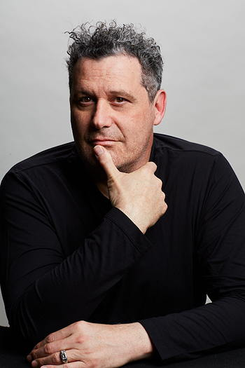 Isaac Mizrahi wearing a black shirt