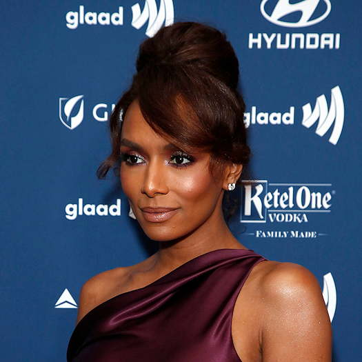 Janet Mock wearing a maroon dress at a glaad event