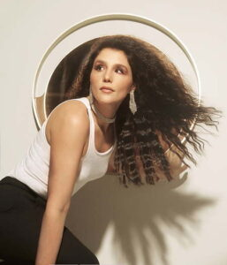 Jessie Ware with long curled hair