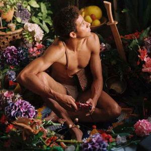 Keiynan Lonsdale kneeling in garden