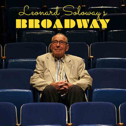 Leonard Soloway sitting in theater seats