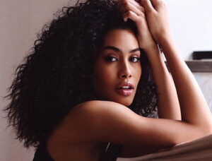 Leyna Bloom with curly black hair