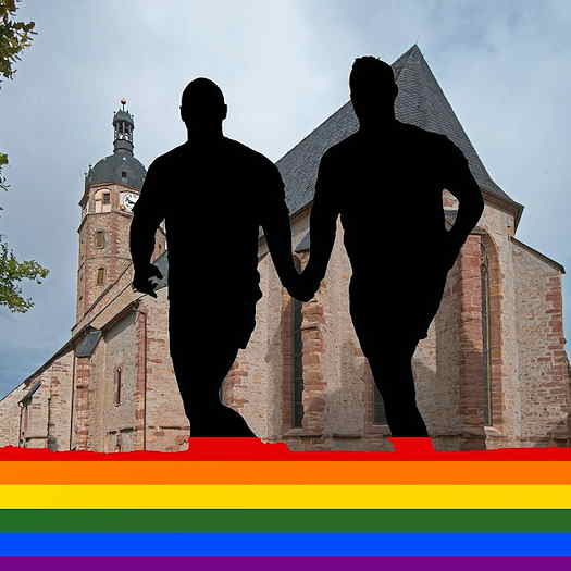 silhouette of two men in front of a church
