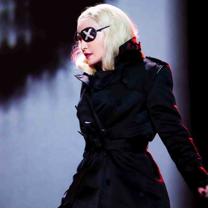Madonna wearing a black jacket and a eye patch