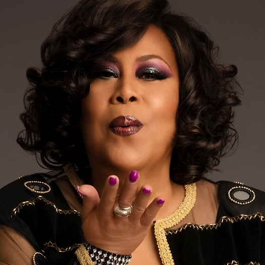 Martha Wash blowing a kiss