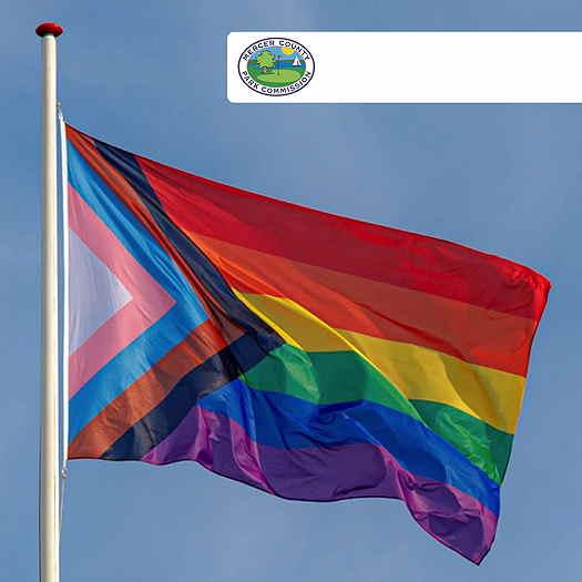 Progressive Pride flag waving in the wind