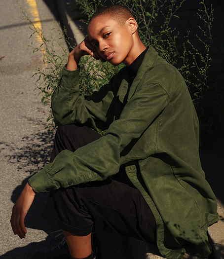 Mikaela sitting on curb
