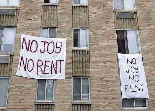 Signs hanging outside windows saying No Job, No Rent