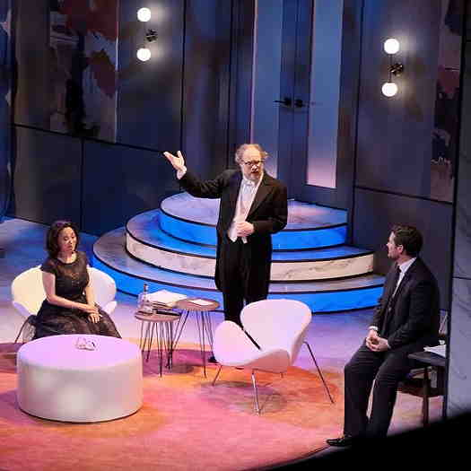 Three people on stage performing the show, It's Only A Play