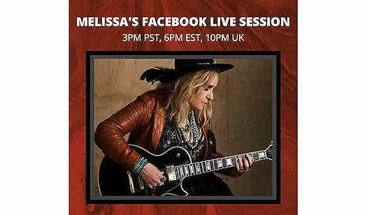 Melissa Etheridge playing guitar