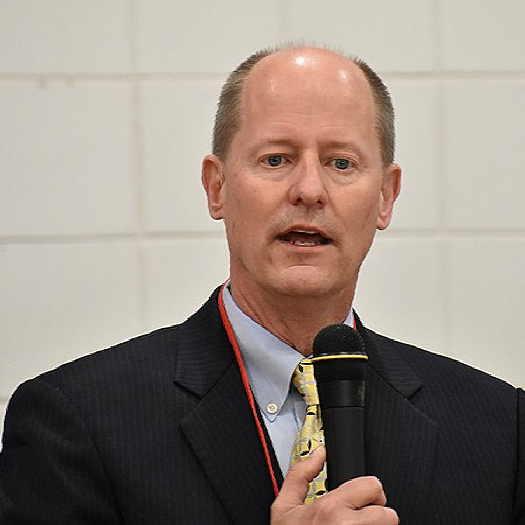 Paul Gazelka holding microphone