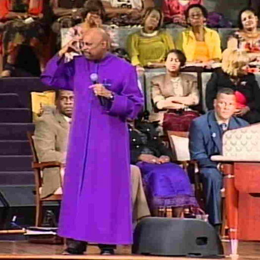 Paul S. Morton, Sr. on stage wearing a purple robe