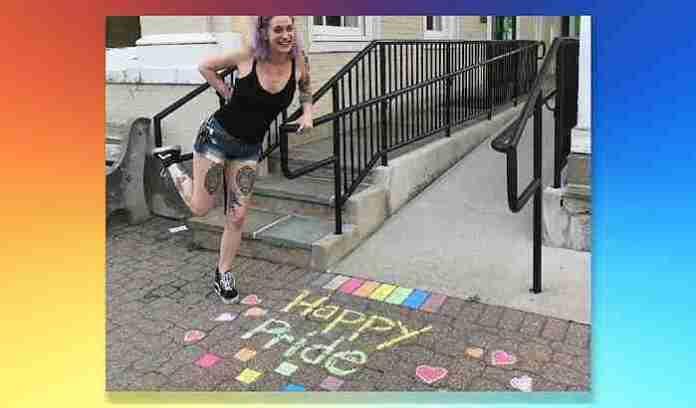 A young lady chalk drawing on sidewalk