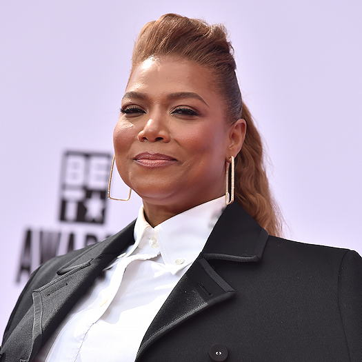 Queen Latifah wearing a white shirt with a black suit jacket