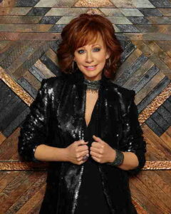 Reba McEntire wearing a black sequin jacket