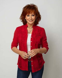 Reba McEntire wearing a red blouse