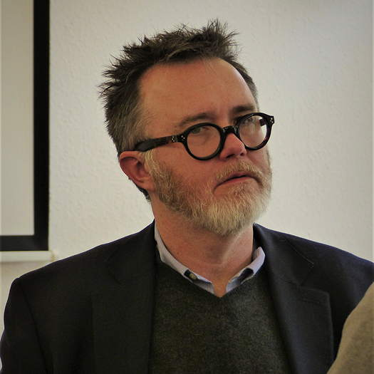 Rod Dreher wearing glasses