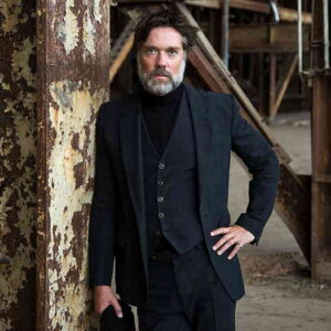 Rufus Wainwright wearing a black suit