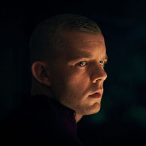 Russell Tovey looking to his right