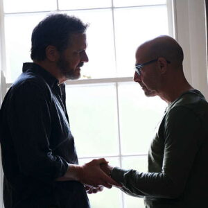 Stanley Tucci holding hands