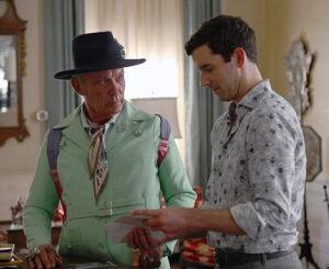 Two men talking one is older.