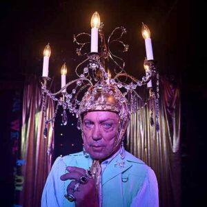 Man wearing chandelier hat