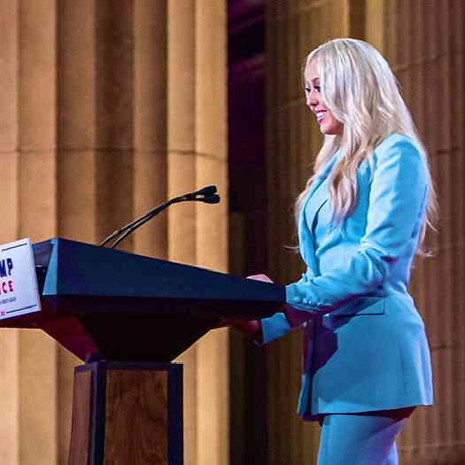 Tiffany Trump standing at Trump, Pence podium