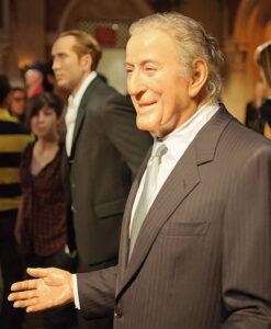 Tony Bennett wearing a grey suit