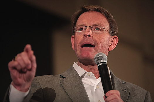 Tony Perkins holding a microphone
