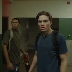 Sam and Tyler looking down hallway