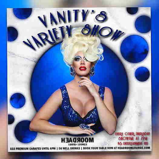 Vanity Ray wearing a blue dress