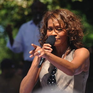 Whitney Houston holding microphone